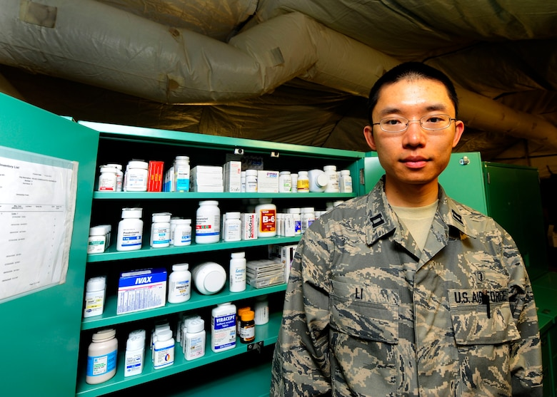 Capt. Tak Li stands with some of the medication the Expeditionary Medical hospital offers March 16, 2010, in Angol, Chile. While the local hospital in Angol is being rebuilt, this medical facility will provide much needed space to provide medical care for the local community. The hospital will include several tents for care, including an emergency room and an operating room. The Air Force expeditionary medical team will provide assistance in the hospital as long as support is requested by local officials. Captain Li is a pharmacist assigned to the 81st Medical Diagnostic and Therapeutic Squadron at Keesler Air Force Base, Miss. (U.S. Air Force photo/Senior Airman Tiffany Trojca)