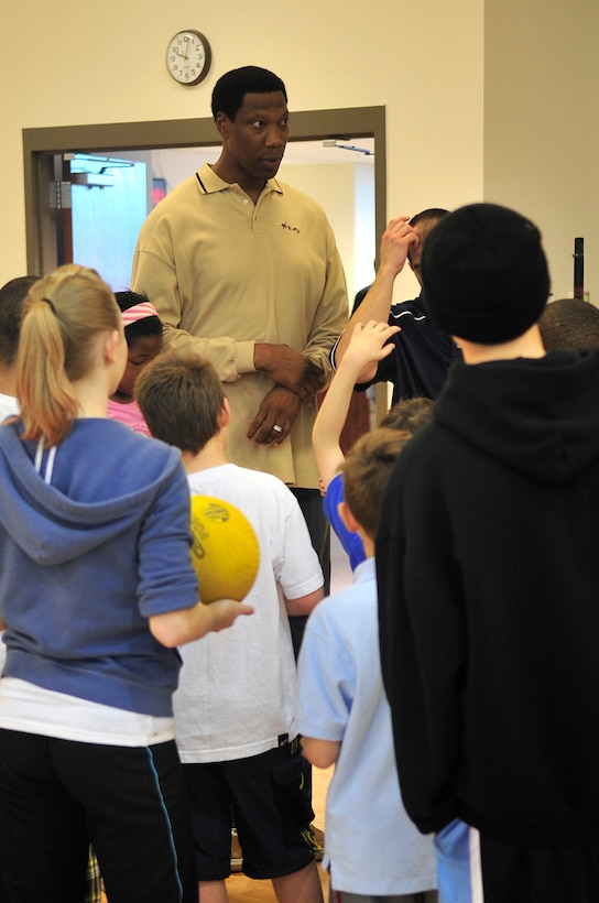 BUCKLEY AIR FORCE BASE, Colo. -- Former Denver Nuggets center Ervin Johnson visits Buckley for the annual Fit Factor Family event at the Buckley Fitness Center March 13. The former National Basketball Association player spoke with the kids and helped them with some free throws. (U.S. Air Force photo by Airman 1st Class Manisha Vasquez)