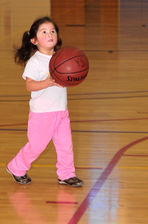 BUCKLEY AIR FORCE BASE, Colo. -- Veronica Estrada, daughter of Senior Master Sgt. Gabriel Estrada, plays basketball during the Fit Factor Family event at the Buckley Fitness Center March 13. (U.S. Air Force photo by Airman 1st Class Manisha Vasquez)