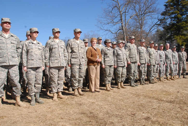 "The Honorable M. Jodi Rell, governor of Connecticut, ""falls in"" with the troops of the 103rd Maintenance Squadron's Centralized Intermediate Repair Facility for a photo opportunity after throwing the first shovelful of dirt during a groundbreaking ceremony to celebrate the start of construction on the CIRF. The new facility will boost work and training space to roughly 30,000 square feet and will house approximately 80 technicians that work on the engines for Air National Guard and active-duty A-10s. (U.S. Air Force photo by Tech. Sgt. Erin McNamara)"