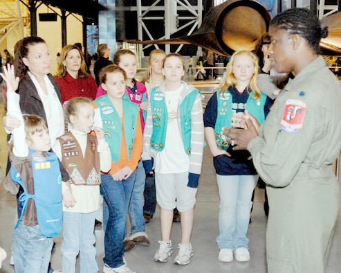 Lt. Col. Merryl Tengesdal answers questions about being a U-2 pilot during the annual Women in Aviation and Space Family Day at the National Air and Space Museum Udvar-Hazy Center in Chantilly, Va., March 13, 2010. Airmen had the chance to talk to young girls about being female aviators. Colonel Tengesdal is the Detachment 2 commander for flight testing at Edwards Air Force Base, Calif. (U.S. Air Force photo/Staff Sgt. J.G. Buzanowski)