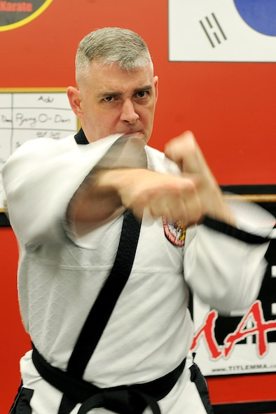 OFFUTT AIR FORCE BASE, Neb. - Technical Sgt. Michael Munyon, with the 55th Security Forces Squadron, practices his punches prior to teaching a hapkido class at an Omaha dojang March 12. Sergeant Munyon currently holds a 5th degree black belt in Taekwondo and a 2nd degree black belt in Hapkido, another form of Korean martial arts. He was recently inducted into the Masters Hall of Fame.