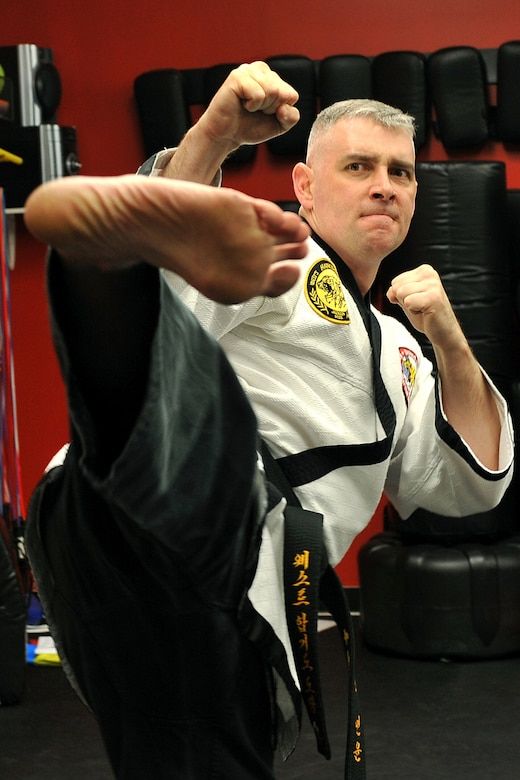OFFUTT AIR FORCE BASE, Neb. - Technical Sgt. Michael Munyon, with the 55th Security Forces Squadron, practices sidekicks prior to teaching a hapkido class at an Omaha dojang March 12. Sergeant Munyon currently holds a 5th degree black belt in Taekwondo and a 2nd degree black belt in Hapkido, another form of Korean martial arts. He was recently inducted into the Masters Hall of Fame.