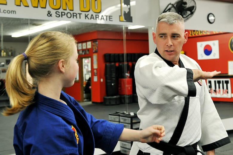 OFFUTT AIR FORCE BASE, Neb. - Abby Wolfe attempts to grab the wrist of Tech. Sgt. Michael Munyon, with the 55th Security Forces Sqaudron, during hapkido class at an Omaha dojang March 12. Sergeant Munyon currently holds a 5th degree black belt in Taekwondo and a 2nd degree black belt in Hapkido, another form of Korean martial arts. He was recently inducted into the Masters Hall of Fame.  U.S. Air Force Photo by Charles Haymond