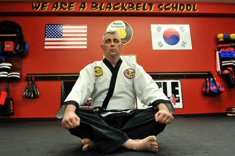 OFFUTT AIR FORCE BASE, Neb. - Technical Sgt. Michael Munyon, with the 55th Security Forces Squadron, meditates before teaching a hapkido class at an Omaha dojang March 12. Sergeant Munyon currently holds a 5th degree black belt in Taekwondo and a 2nd degree black belt in Hapkido, another form of Korean martial arts. He was recently inducted into the Masters Hall of Fame.