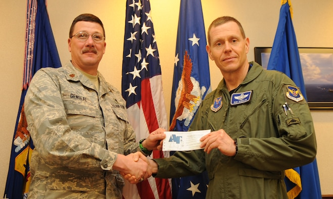 WHITEMAN AIR FORCE BASE, Mo. - Brig. Gen. Robert E. Wheeler, 509th Bomb Wing commander, gives his Air Force Assistance Fund donation form to Chaplain (Maj.) Patrick Genseal, AFAF project officer, March 17, 2010. The Air Force Assistance Fund campaign kicked off March 8, 2010 and will run through April 16, 2010. (U.S. Air Force photo/Senior Airman Stephen Linch)