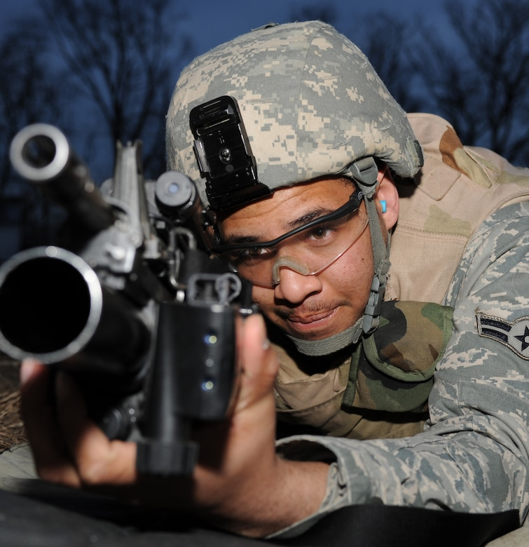 WHITEMAN AIR FORCE BASE, Mo. - Airman 1st Class Troy Young, 509th Security Forces Squadron, prepares to fire the M-203 grenade launcher attachment during training here March 8, 2010. (U.S. Air Force photo/Airman 1st Class Carlin Leslie)