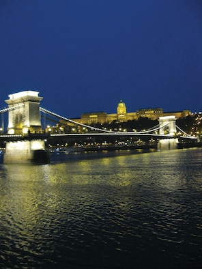 Light reflects off the Chain Bridge onto the Danube River in Budapest, Hungary Oct. 12, 2009. The bridge connects the once divided cities of Buda and Pest. (U.S. Air Force photo/2nd Lt. Brian Wagner)