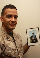 Staff Sgt. Trinity A Lizalde holds a photo of him and his son, Diego, after his discharge from the hospital March 19 on Camp H.M. Smith, Hawaii. Lizalde's son contracted leukemia Nov. 9, 2007. His family was forced to move from Okinawa, Japan to Hawaii after living there for only six weeks to save their son. Facing financial hardship due to the move, Lizalde turn