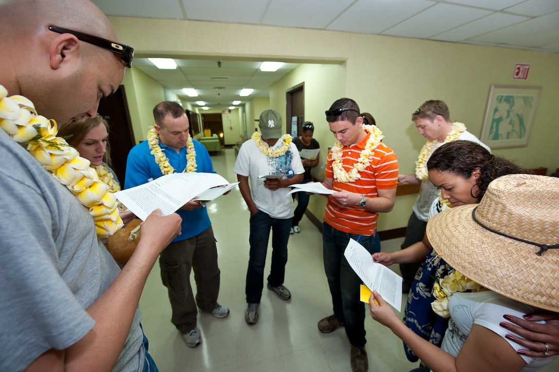 U.S. Air Force Staff Sgt. Harry Mitchell (left), Medical Technician, 140th Wing Medical Group, Buckley Air Force Base, reads a data sheet to the group about the ethnic facts & figures of the Hawaiian population at the cultural familiarization briefing, Kahuku Medical Center, Kahuku, Hawaii, March 14, 2010. Mitchell and more than 60 of his fellow Colorado Air National Guardsman are on the island of Oahu providing services to the medically under-served within the State of Hawaii (U.S. Air Force photo/Master Sgt. John Nimmo, Sr.) (RELEASED)