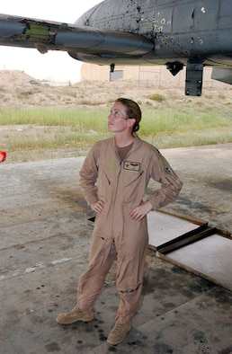 Then-Capt. Kim Campbell surveys the battle damage to her A-10 Thunderbolt II at a base in Southwest Asia. Captain Campbell's A-10 was hit over Baghdad during a close air support mission on April 7, 2003. At the time she was  deployed with the 332nd Air Expeditionary Wing. (Courtesy photo)