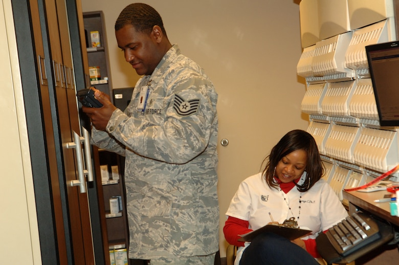 BUCKLEY AIR FORCE BASE, Colo. -- Tech. Sgt. Major Strickland, 460th Medical Group pharmacy technician, dictates medications for restocking to Tanya Hackett, certified pharmacy technician, March 17 at the Buckley Air Force Base pharmacy. (U.S. Air Force photo by Tech. Sgt. Shirley Henderson)