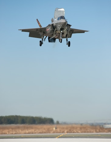 An F-35B Joint Strike Fighter descends to its first vertical landing March 18, 2010, at the Naval Air Station in Patuxent River, Md., confirming the future Marine Corps aircraft's ability to land in confined areas. During the test, the plane, which is slated to replace all Marine Corps combat jets, rode 41,000 pounds of thrust from its single engine to land on the runway 150 feet below. Despite delays and budget overages within the JSF program, the Marine Corps is on track to reach an initial operating capability of 29 planes by December 2012.