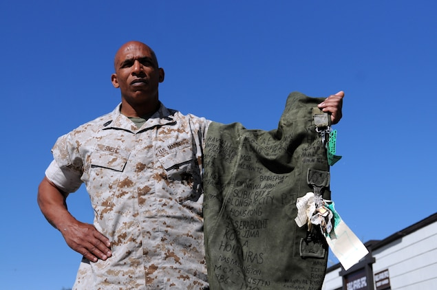 Master Sgt. Michael B. Snell, Marine Attack Squadron 214 maintenance chief, displays the sea bag he received in boot camp, on which he wrote down all the places he's seen and units he's been a part of throughout his 23-year-old military career in 2010. The bag has more than 30 locations from 20 countries around the world, some with Roman numerals to reflect multiple visits. VMA-214 is stationed at the Marine Corps Air Station in Yuma, Ariz.
