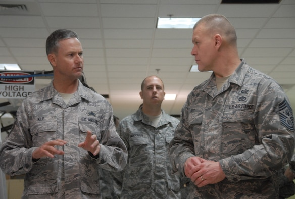 Senior Master Sgt. Kevin Kile, 16th Electronic Warfare Squadron, speaks to Chief Master Sgt. of the Air Force James Roy about the electronic warfare test mission March 18 at Eglin Air Force Base, Fla.  The CMSAF's two-day visit to the base included tours of units within the various wings and speaking with junior enlisted and senior leadership on Air Force issues.  (U.S. Air Force photo/Samuel King Jr.)