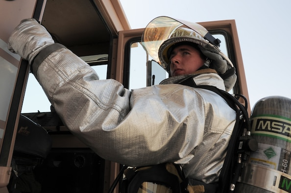 Airman 1st Class Samuel Siewert, firefighter with the 380th Expeditionary Civil Engineer Squadron fire department, climbs out of a fire truck while training at a non-disclosed base in Southwest Asia on March 14, 2010. As an Air Force firefighter, Airman Siewert and his fellow firefighters are responsible for protecting thousands of deployed personnel and billions of dollars of Air Force assets from fire. He is deployed from the 628th Civil Engineer Squadron fire department at Joint Base Charleston, S.C., and his hometown is Oconomowoc, Wisc. (U.S. Air Force Photo/Master Sgt. Scott T. Sturkol)