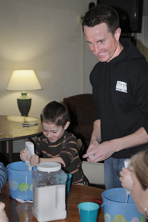 State Youth Coordinator Jeremy VanWyk (right) explains how to make ?slime? to children he is working with who?s parents are attending the Yellow Ribbon Event held at the Holiday Inn Airport in Des Moines, Iowa on March 6, 2010.  Childcare services were offered so parents could attend the event, which is designed to assist military members who have returned home from deployment and offer assistance to them as they transition back into civilian life.  (US Air Force photo/Staff Sgt. Linda E. Kephart)(Released)