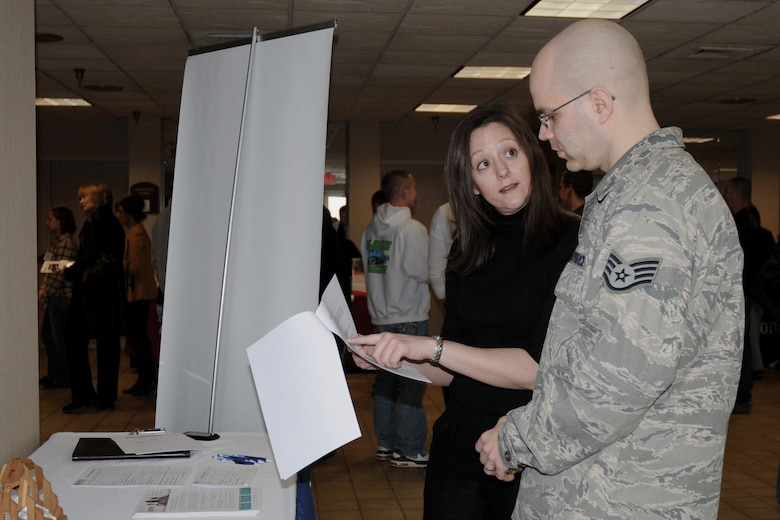 Staff Sgt. Taylor York (right) listens intently as Military Medicine (M2M) representative Heidi Carter (left) reviews information with him about what the M2M program has to offer.  Sgt. York recently returned from deployment and is attending the Yellow Ribbon Event being held at the Holiday Inn Airport in Des Moines, Iowa on March 6, 2010.  (US Air Force photo/Staff Sgt. Linda E. Kephart)(Released)
