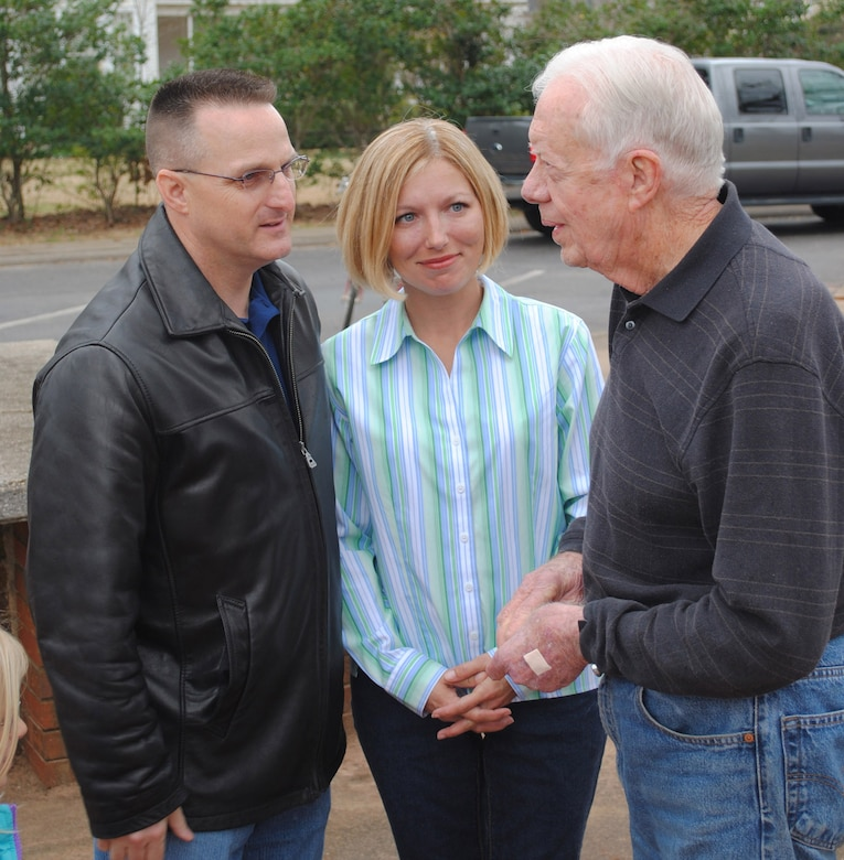 "Chief Master Sergeant Harold ""Buddy"" Hutchison, 78th Air Base Wing command chief, and his wife Tonya, meet  and talk with President Jimmy Carter during a stop in Plains on the Airman and Family Readiness Center train trip for Robins' deployed family members. U. S. Air Force photo by Tech. Sgt. Vann Miller"