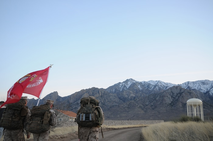 Yuma-based Marines Lance Cpl. Anthony Scott, left, Lance Cpl. Shane Fields and Gunnery Sgt. Fred Suniga march the last mile of the 2010 Bataan Memorial Death March at White Sands Missile Range, N.M., March 21, 2010. The annual 26.2-mile march is held in memory of the nearly 75,000 American and Filipino service members forced to march across 90 miles of the Philippine Bataan peninsula with limited rations and harsh heat while interned by the Japanese in 1942. For over 10 hours, the Marines endured debilitating weather, high altitudes and unforgiving terrain. Throughout the course, the Marines stopped for rest and medical treatment, but never quit. At least nine Marines from the Marine Corps Air Station in Yuma, Ariz., participated in the event.