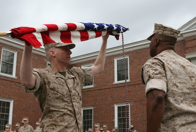 Lt. Col. Eric Davis (left), the commanding officer of Combat Logistics Battalion 46, 2nd Marine Logistics Group, and Sgt. Maj. Derrick Smith (right), the CLB-46 sergeant major, case their unit's colors during a deactivation ceremony aboard Camp Lejeune, N.C., March 22, 2010.  The all-reserve battalion, which is made up of 900 Marines from 70 reserve sites spanning across 42 states, was activated for the first time in June 2009 to deploy in support of Operation Iraqi Freedom.