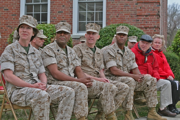 (From left to right) Brig. Gen. Tracy Garrett, the 4th Marine Logistics Group commanding general; Sgt. Maj. Alexander Williams, 4th MLG sergeant major; Lt. Col. Eric Davis, commanding officer of Combat Logistics Battalion 46, 2nd Marine Logistics Group; Sgt. Maj. Derrick Smith, CLB-46 sergeant major; and the parents of Davis, listen to a speech given by Brig. Gen. Juan G. Ayala, the 2nd MLG commanding general, during a deactivation ceremony aboard Camp Lejeune, N.C., March 22, 2010.  The all-reserve battalion, which is made up of 900 Marines from 70 reserve sites spanning across 42 states, was activated for the first time in June 2009 to deploy in support of Operation Iraqi Freedom.