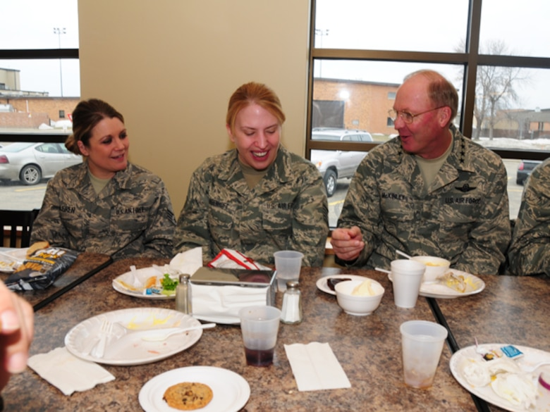Gen. Craig R. McKinley, chief of the National Guard Bureau, laughs with Staff Sgt. Kristi Krabbenhoft, 119th Wing, while eating lunch at the 119th Wing on March 22.  McKinley ate with more than a dozen North Dakota Guardsmen and took time to talk about the ongoing flood operations taking place in the area.