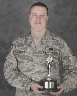 Tech. Sgt. Matthew Flowers pictured with the coveted Roger Award. Sgt. Flowers won the award for top technician during the annual Air Force Worldwide Talent Search held 17-25 January at Lackland AFB, Texas. Sgt Flowers a munitions system technician with the 132nd Fighter Wing, Iowa Air National Guard will be joining Tops In Blue for their 2010 season in March as a result as a result of the competition. Sergeant Flowers will be the groups lighting and technical director.(USAF photo/Senior Master Sgt. Tim Day)(released)