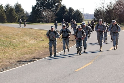 Members from the Air Force Mortuary Affairs Operations Center here participate in the 436th Security Forces Squadron's 11th Annual Ruck March held March 20. The annual 6.2 mile march is a fundraiser to honor the veterans of the Korean War who fought in the Battle of the Chosin Reservoir. (U.S. Air Force photo/Master Sgt. Robert Snyder)