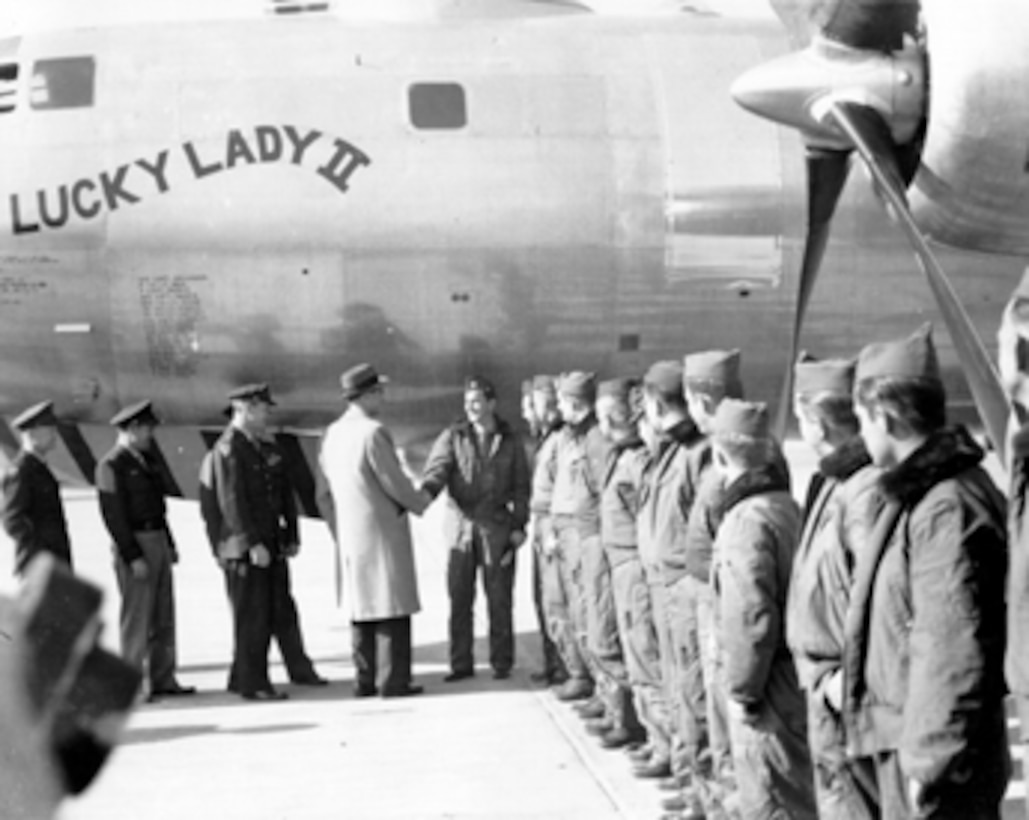 Lucky Lady II crew members are greeted by Air Secretary Stuart Symington and Gen. Hoyt Vandenberg following the first non-stop flight around the world.