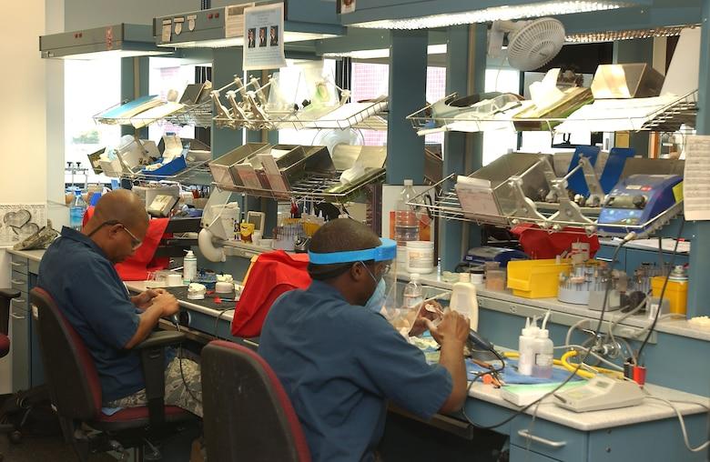 Dental technicians at the David Grant USAF Medical Center's Arthur J. Sachsel Dental Clinic work at crafting new dental implants for patients. (U.S. Air Force photo / SrA Lilliana E Moreno-Miranda)