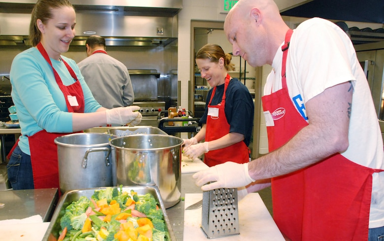 Capt. Gena Parkman and Master Sgts. Kim Mann and Dan Spain prepare meals at Marian House March 2, 2010. The three Airmen are part of the Air Force Academy's Unit Advisory Council. Captain Parkman is assigned to the Academy's Cadet Counseling Center. Sergeant Mann is superintendent of Cadet Wing Human Relations, and Sergeant Spain is superintendent of Basic Cadet Training. (U.S. Air Force photo/Ann Patton)