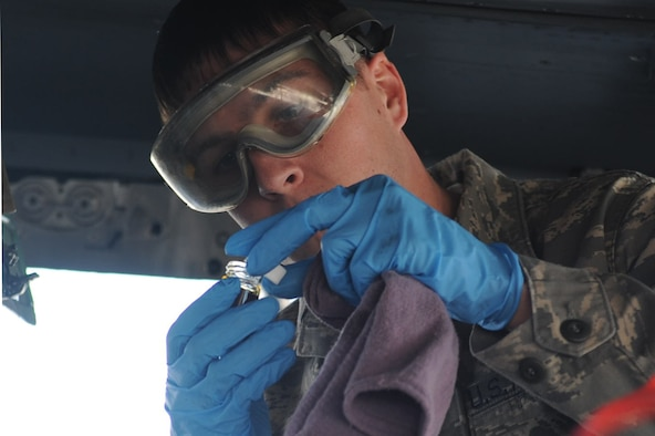 Senior Airman Bobby Kerr, 307th Fighter Squadron reservist crew chief, closes the lid of a joint oil analysis program sample on Seymour Johnson Air Force Base, N.C., March 19, 2010. Crew chiefs take an oil sample after an aircraft lands to ensure the engine is working properly. Kerr hails from Boone, N.C. (U.S.  Air Force photo/Senior Airman Whitney Lambert)