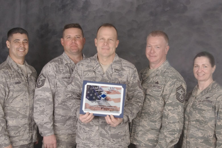 Tech. Sgt. Paul Havran (holding certificate) is awarded the Diamond Sharp award for March 2010. Sergeant Havran is recognized for his his selfless dedication to retention, unwavering professionalism and his work with the student flight in preparing the next generation of Airmen. Sergeant Havran, retention office manager for the 132nd Fighter Wing, Force Support Squadron, Iowa Air National Guard was recently selected by the Air National Guard as ?Rookie Retention Office Manager of the Year?. (U.S. Air Force photo/Staff Sgt. Linda E. Kephart)(released)