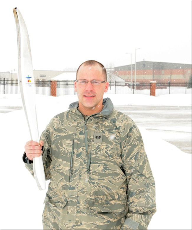 Staff Sgt. Thomas Ries, 114th Maintenance Squadron member, displayed the torch he carried for the 2010 Winter Olympics in Vancouver, British Columbia.  Sgt. Ries was chosen by his employer to be one of the torch bearers for this historic event.