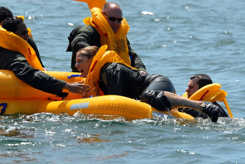 Lt. Col. April Vogel, C-38 Pilot, 201st Airlift Squadron / NGB / J-3-5, climbs into the AC9 Raft as part of water survival training at Naval Air Station Key West, Fla. Mar 15. (U.S. Air Force photo by Tech. Sgt. Tyrell Heaton/Released)