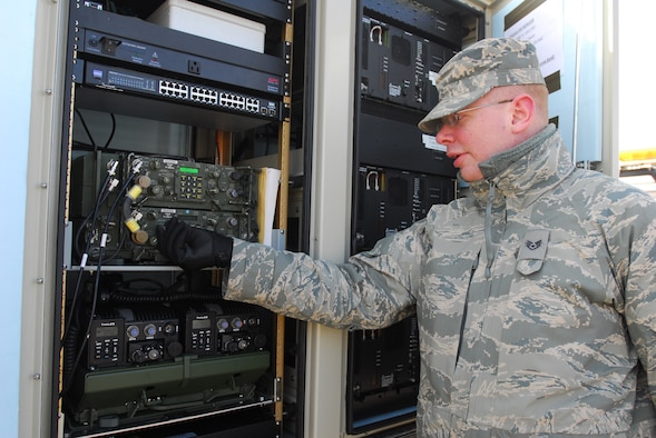 Staff Sgt. Jeff Lansca, Communications Squadron, 148th Fighter Wing makes a few radio adjustments on the Remote Communications Platform used to support the spring flood fighting operations in Moorhead, Minn. Mar. 20.