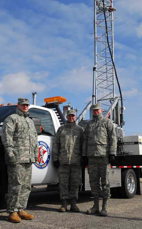 Minnesota National Army and Air National Guard members form a joint team to operate and maintain the Remote Communications Platform deployed to Moorhead in support of local authorities battling spring floods. The team is (l-r) Staff Sgt. Troy Tretter, D Co., 1-194 Combined Arms Battalion, Master Sgt. Bryan Druer and Staff Sgt. Jeff Lansca, Communications Squadron, 148th Fighter Wing.