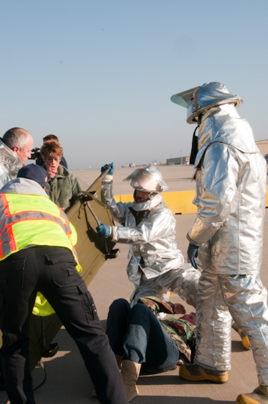 The 139th Airlift Wing conducts a major accident response exercise at Rosecrans Airport, St. Joseph, Mo. on March 18, 2010. The exercise was in anticipation of an upcoming airshow and included state, local and Air National Guard agencies. (U.S. Air Force photo by Master Sgt. Shannon Bond/Released)