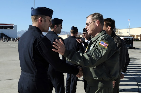 "Gen. William M. Fraser III meets Capt. Paul Jelinek following the team's acceptance show March 11, 2010, at Nellis Air Force Base, Nev. General Fraser is the commander of Air Combat Command, and Captain Jelinek is the Air Force Air Demonstration Squadron ""Thunderbirds"" opposing solo pilot. (U.S. Air Force photo/Staff Sgt. Richard Rose)"
