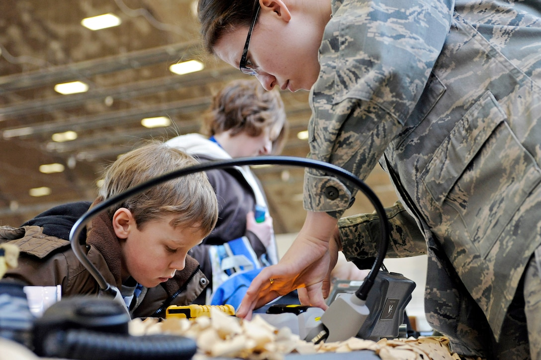Senior Airman Carolyn Southards shows a military child how an identification kit can verify different substances March 13, 2010, at Ellsworth Air Force Base, S.D. The focus of the event was to give families of Airmen a better understanding of what it means to deploy. Airman Southards is a 28th Civil Engineer Squadron emergency management journeyman. (U.S. Air Force photo/Airman 1st Class Matthew Flynn)