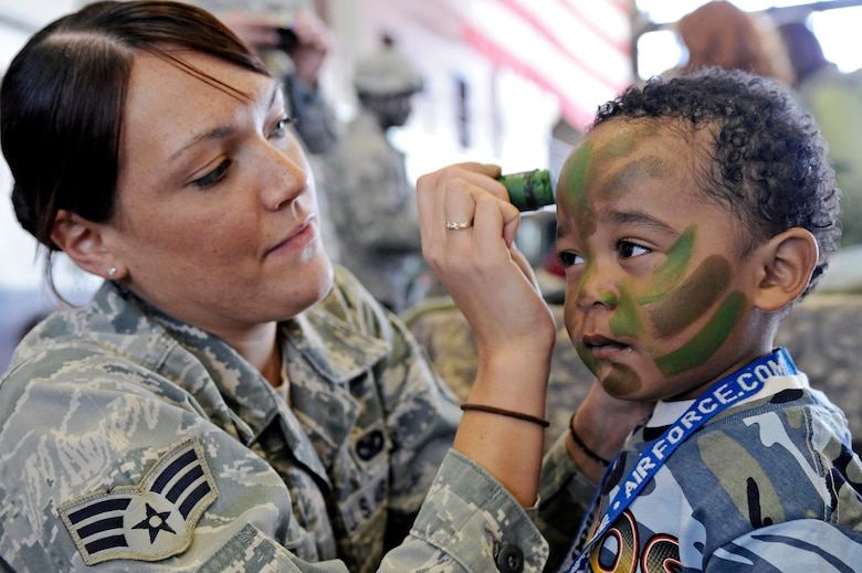 Senior Airman Melanie Allen paints the face of a child during the Kids, Spouses and Teachers Understanding Deployment Operations event March 13, 2010, at Ellsworth Air Force Base, S.D. Airman Allen is a 28th Security Forces Squadron training instructor. (U.S. Air Force photo/Airman 1st Class Matthew Flynn)