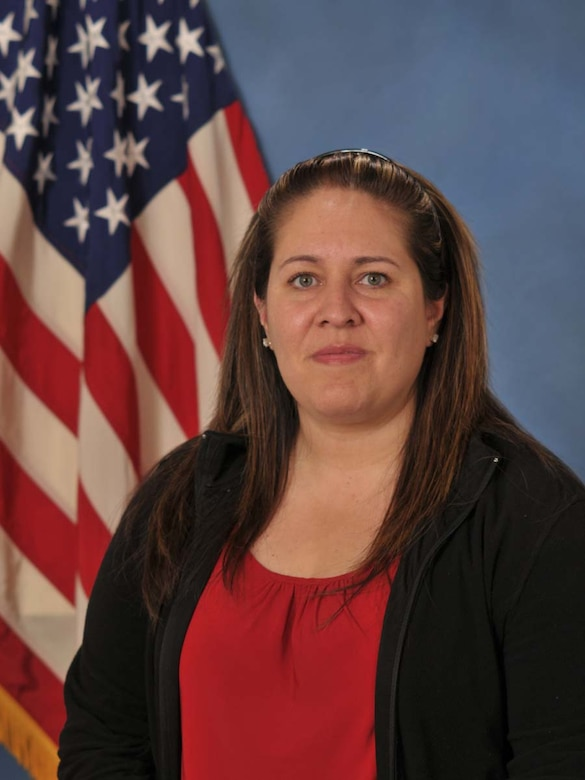 Ms. Liza Ojeda-Agushi from the Headquarters Air Force Operational Test and Evaluation Center's Manpower, Personnel and Training Directorate at Kirtland AFB, N.M., is the 2009 AFOTEC Category III Civilian of the Year.