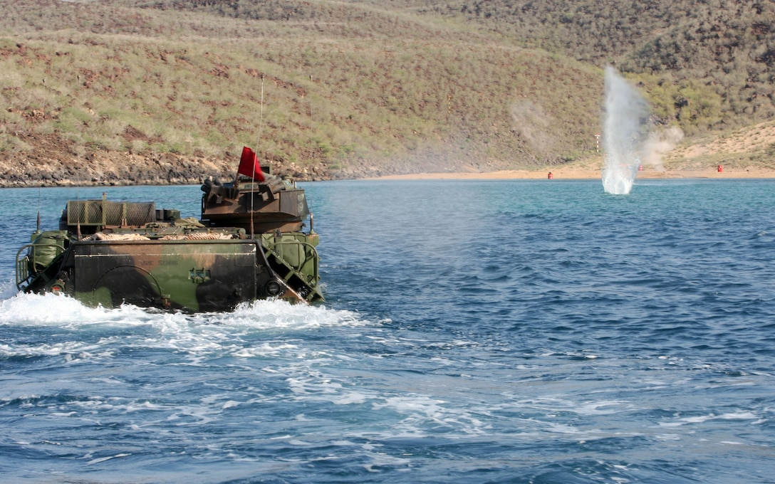 Assault Amphibious Vehicle (AAV) crewmen from the AAV platoon, Battalion Landing Team 1st Battalion, 9th Marine Regiment, 24th Marine Expeditionary Unit, conduct a water gunnery range at a beach in Djibouti, Africa, March 25, 2010.  The water range was the first time in 20 years that this AAV platoon performed this type of aquatic marksmanship training.  The range was one of a series of sustainment and bilateral exercises the 24th MEU conducted in the east-African country throughout the month of March.  The 24th MEU is currently on a seven-month deployment aboard ships of the Nassau Amphibious Ready Group and is currently the theatre reserve force for Central Command.  (U.S. Marine Corps photo by Gunnery Sgt. Chad R. Kiehl)