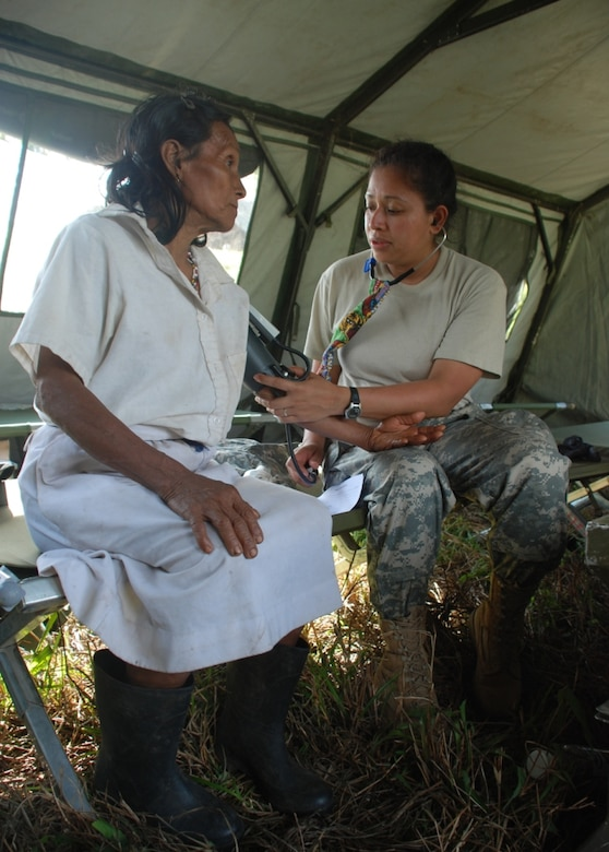 Army 1st Lt. Judiza Zelaya, Medical Element registered nurse, checks the blood pressure of a Costa Rican woman during a medical civic assistance program, or MEDCAP, held March 24-26 in Piedra Meza, Costa Rica.  A total of 253 patients received care during the MEDCAP, conducted by 15 Joint Task Force-Bravo Medical Element personnel, in cooperation with Costa Rican healthcare providers, the Costa Rican police and members of the U.S. Military Group in Costa Rica. (U.S. Air Force photo by 1st Lt. Jen Richard)