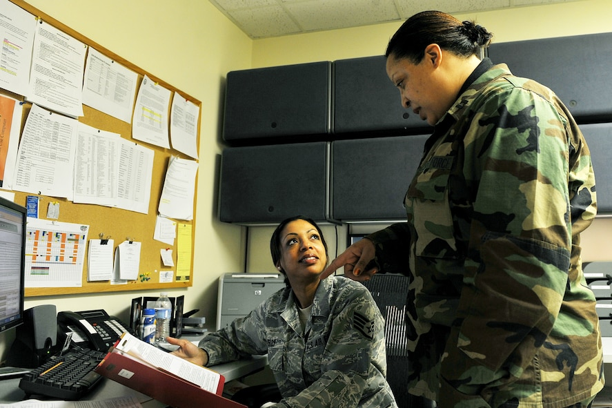 OFFUTT AIR FORCE BASE, Neb. -- Staff Sgt. Andrea Perry, a medical technician with the 55th Medical Operations Squadron, receives tips from Capt. Felisa Wilson, a group practice manager also with the 55th MOS, on ways to improve her Airman's enlisted performance report at the Ehrling Bergquist Clinic here March 25. Captain Wilson as an avid volunteer in the community and is involved with a number of organizations including, the Drug Education for Youth program and Offutt's Company Grade Officer's Council, where she serves as the president. U.S. Air Force photo by Charles Haymond