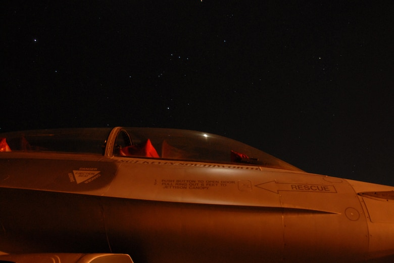 One of eight F-16C Fighting Falcon from the Air National Guard's 115th  Fighter Wing in Madison, Wis., rests below a star filled sky March 23, 2010, at Naval Air Station Key West., Fla.  Close to 145 Airmen of the 115th Fighter Wing in Madison, Wis., spent approximately two weeks at Naval Air Station, Key West, gaining valuable training as their F-16 Falcons sparred against Navy F-18 Super Hornets and F-5 Tigers here.  (U.S. Air Force photo by Airman 1st Class Ryan Roth, 115 FW/PA)