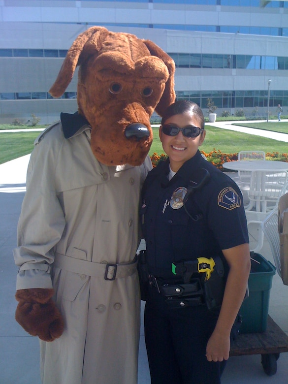DOD Police Officer Yvette Perez poses with McGruff the Crime Dog. (Courtesy photo)