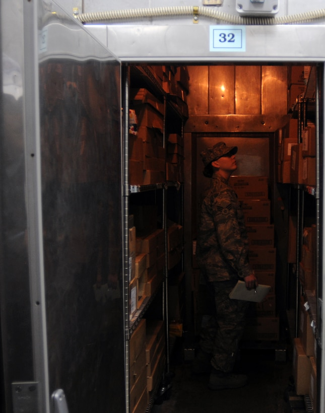 Senior Airman Christina Moran, 39th Medical Group Public Health technician, inspects a food storage room inside the Sultan's Inn at Incirlik Air Base, Turkey. Public Health has an array of responsibilities when it comes to keeping the base healthy including inspecting all facilities that serve food on base, ensuring the readiness of deploying Airmen and educating the public about safe sex. (U.S. Air Force photo/Senior Airman Sara Csurilla)
