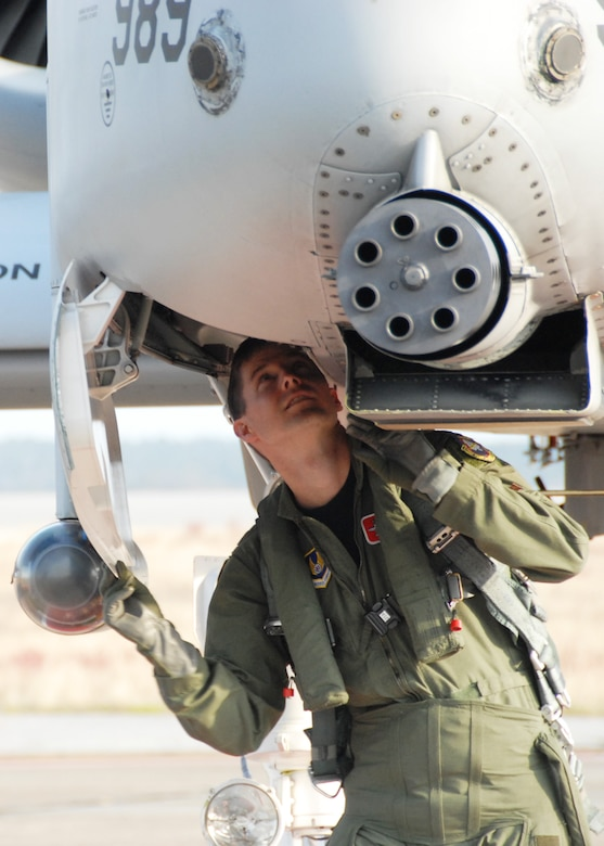 EGLIN AIR FORCE BASE, Fla. -- Maj. Chris Seager, 40th Flight Test Squadron test pilot, performs pre-flight checks on the A-10C Thunderbolt II as it prepares for the first flight of an aircraft powered solely on a biomass-derived jet fuel blend. The A-10 was fueled with a 50/50 blend of Hydrotreated Renewable Jet and JP-8.  The flight took place here March 25.  (U.S. Air Force photo/Samuel King Jr.)
